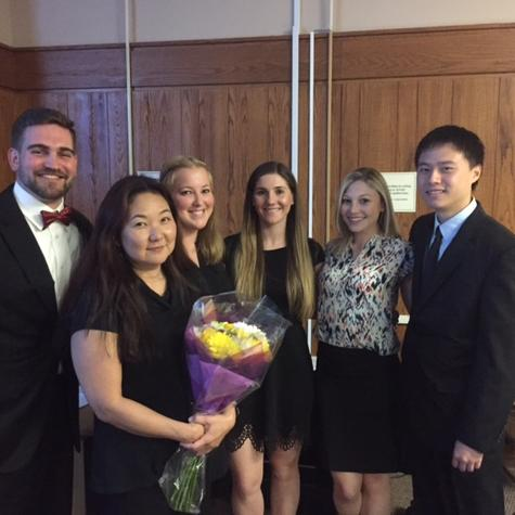 Touro professor June Kume (holding flowers) and her team of DPT students that studied the effect of music on running performance.