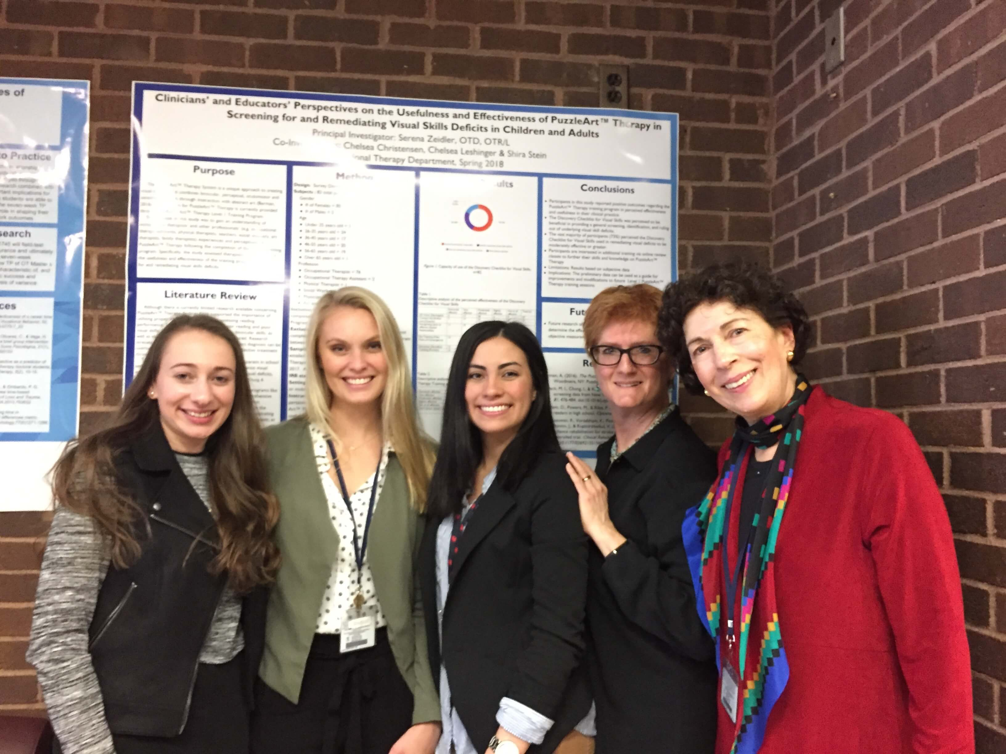 Students at the School of Health Sciences Occupational Therapy program delivered their final presentations in May. Above, students worked with SHS OT Professor Serena Zeidler (far right) to examine the efficacy of a new therapy tool.
