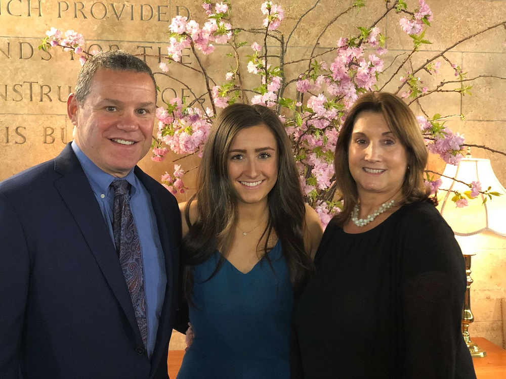 As one of the 42 graduates of Touro\'s School of Health Sciences-Manhattan Physician Assistant program, Alexa DellaTorre (center, flanked by her parents) donned her white coat in a ceremony on May 9. Next year, she will be working in the oncology ward of New York Presbyterian Weill Cornell Medical Center.