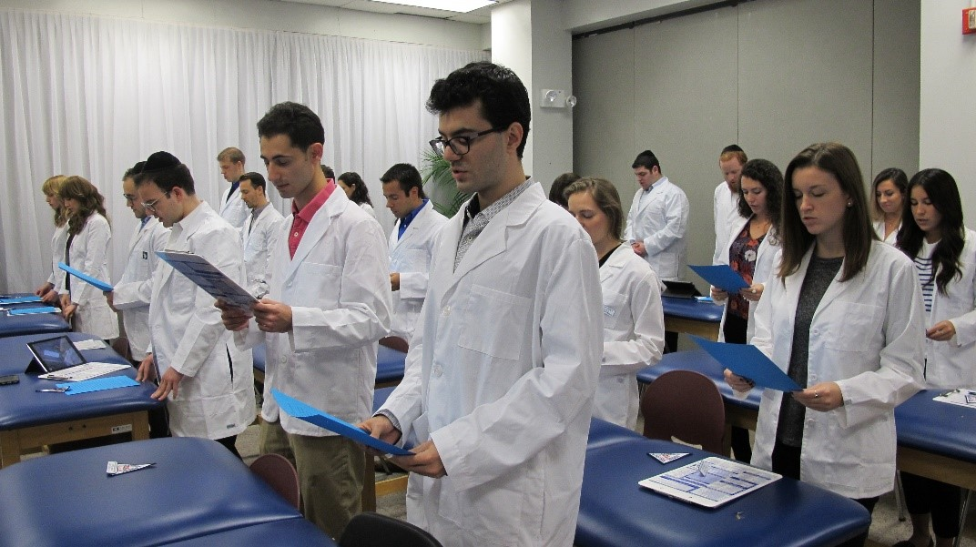 Students from the Manhattan campus recite the Physical Therapy Professional Pledge at their White Coat Ceremony.