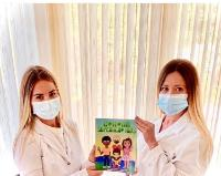 Occupational therapists and Touro School of Health Sciences alums Diana Gosteva and Anna Astrova pose with their new book.